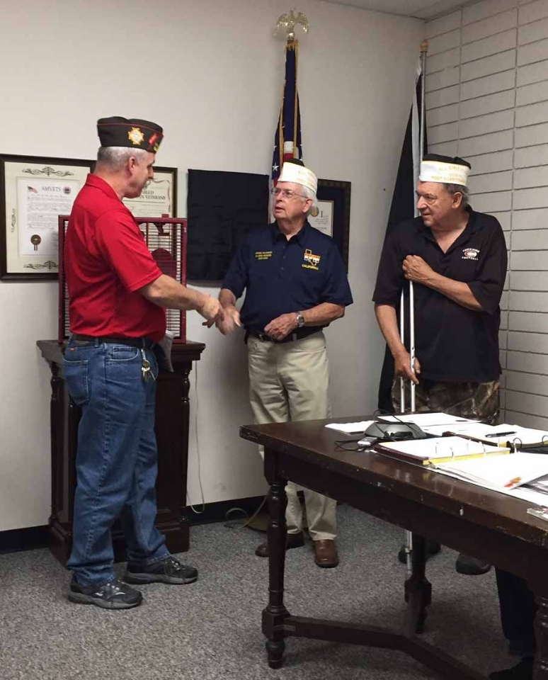 Commander Mike Halldorson and Quartermaster Mike Hall receive the All State Post Award from Jerry Brady, State Adjutant.